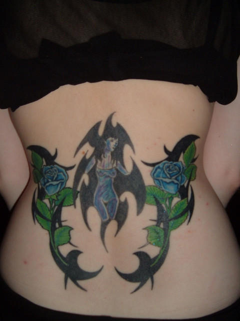 organic plant like tribal tattoo on hips and lower back