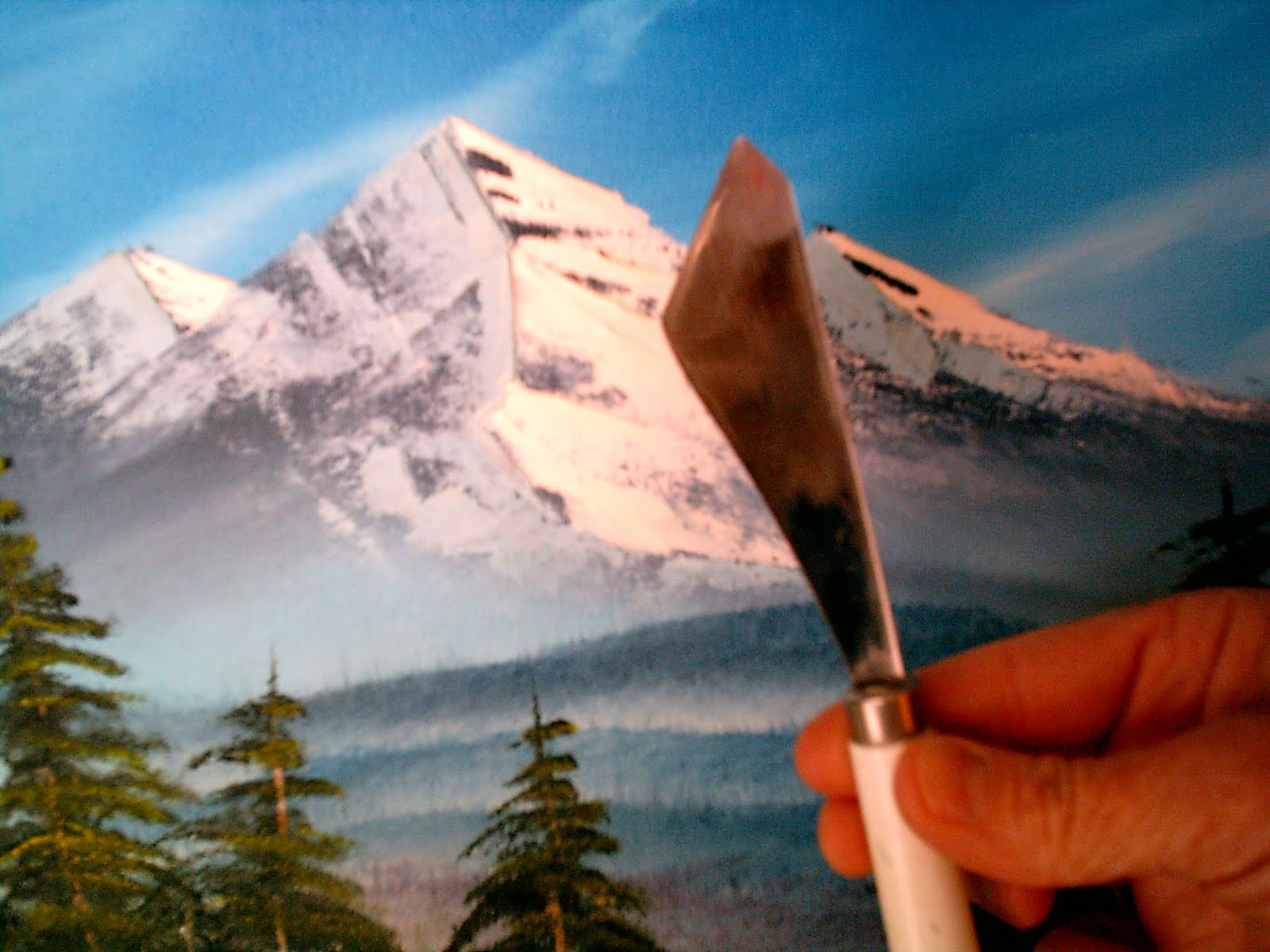 happy little trees studio using the bob ross painting knife for