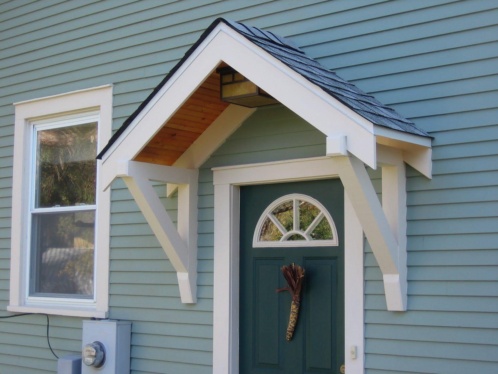 Bungalow restoration side door overhang for Front door roof designs