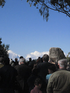 Myall Creek Memorial ceremony participants listen to the bull roarer