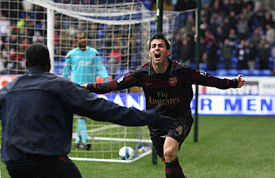 Cesc Fabregas of Arsenal celebrates the own goal