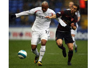 El Hadji Diouf of Bolton Wanderers and Mathieu Flamini of Arsenal compete