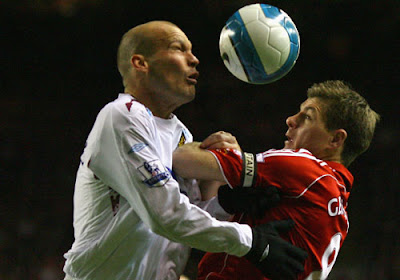 Freddie Ljungberg of West Ham battles with Steven Gerrard of Liverpool