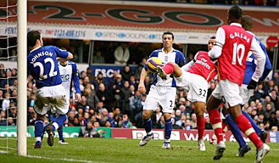 Theo Walcott of Arsenal scores against Birmingham City.