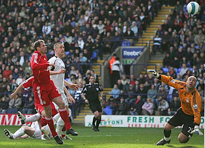Gary Cahill of Bolton hits the bar with an attempt on goal against Liverpool.