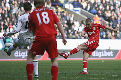 Fabio Aurelio of Liverpool scores his team's third goal against Bolton. Aurelio's first goal for the Reds saw his team beat Bolton 3-1.