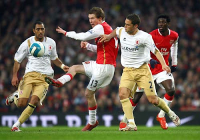 Alexander Hleb of Arsenal is closed down by Luke Young of Middlesbrough