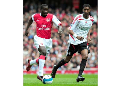 Emmanuel Eboue of Arsenal is closed down by Damien Plessis of Liverpool