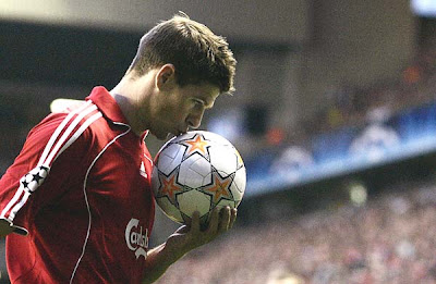 Steven Gerrard kisses the ball as he prepares to take a corner kick against Chelsea.