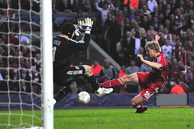 Dirk Kuyt of Liverpool scores the opening goal past Chelsea goalkeeper Petr Cech just ahead of the halftime whistle.