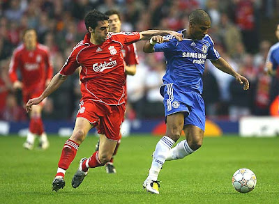 Alvaro Arbeloa of Liverpool tussles for posession with Florent Malouda of Chelsea during the first half.