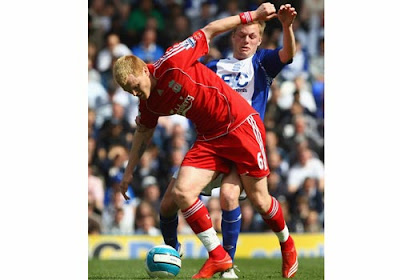 John Arne Riise of Liverpool is challenged by Sebastian Larsson of Birmingham City