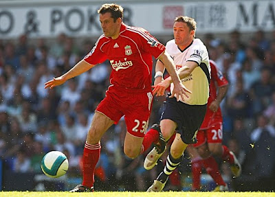 Jamie Carragher of Liverpool is challenged by Robbie Keane of Tottenham Hotspur. The Reds ended their season with a 2-0 victory.