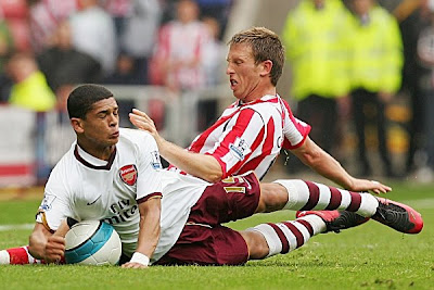 Denilson of Arsenal and Danny Collins of Sunderland battle for the ball. The Gunners closed their season with a 1-0 victory.