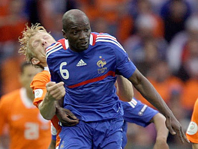 France's Claude Makelele, foreground, hits Netherlands' Dirk Kuyt in the face as they vie for the ball.