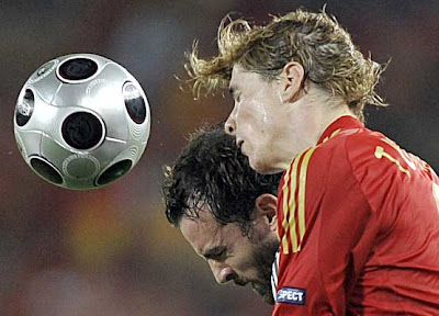 Spain's Fernando Torres and Germany's Christoph Metzelder clash for the ball.