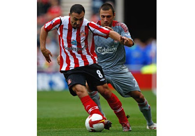 Steed Malbranque of Sunderland is tracked by Andrea Dossena of Liverpool