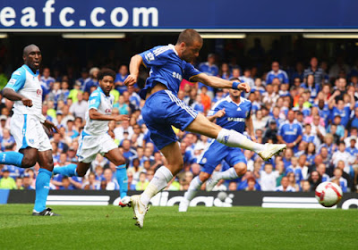 Joe Cole of Chelsea scores the opening goal against Portsmouth.