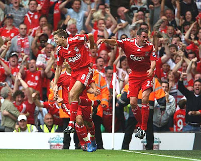 Steven Gerrard of Liverpool celabrates with Jamie Carragher after scoring the winner against Middlesbrough, giving the Reds a 1-0 win and a spot at the top of the Premiership.