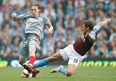 Stiliyan Petrov of Aston Villa tackles Lucas Leiva of Liverpool. Villa held the Reds to a 0-0 draw.