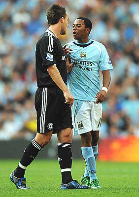New record Premier League signing Robinho of Manchester City and John Terry of Chelsea have words with each other during the match.