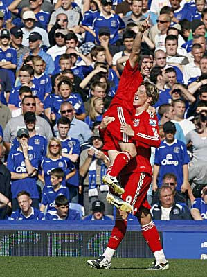 Liverpool forward Robbie Keane (left) congratulates his strike partner Fernando Torres after the Spaniard opened the scoring against Everton.