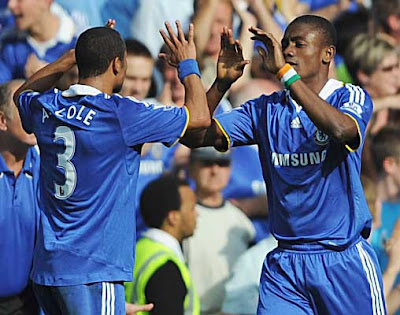 Salomon Kalou (right) of Chelsea celebrates with Ashley Cole after scoring the equalizer against Manchester United. The game eventually ended in a 1-1 draw.
