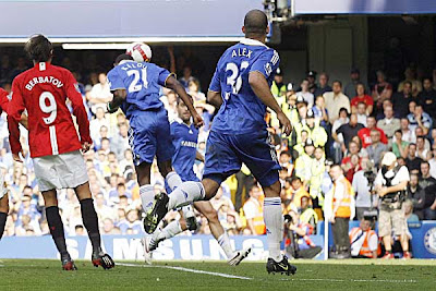 Chelsea striker Salomon Kalou (second left) heads the ball to score against Manchester United.