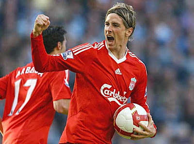 Fernando Torres of Liverpool celebrates after scoring against Manchester City. Torres scored twice for the Reds.