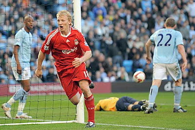 Liverpool forward Dirk Kuyt celebrates after scoring the third goal and winner against Manchester City in the dying moments of the game. The Reds rallied from two goals down to win the clash 3-2.