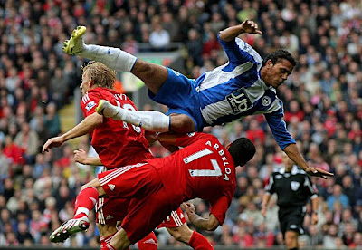 Wigan striker Amr Zaki flies through the air during the Barclays Premier League match between Liverpool and Wigan Athletic at Anfield in Liverpool, England.