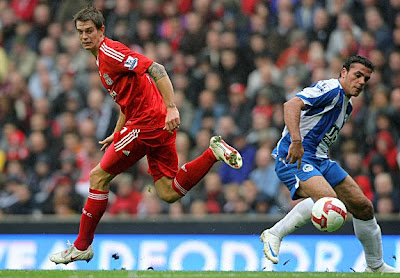 Wigan's Amr Zaki dispossesses Daniel Agger to open the scoring for Wigan.