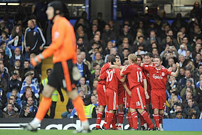 Xabi Alonso (center) of Liverpool celebrates with teammates after scoring against Chelsea inside the opening ten minutes. Alonso's shot took a deflection, wrong-footing Blues goalkeeper Petr Cech