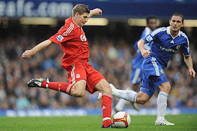 Liverpool captain Steven Gerrard has a shot at goal in front of Chelsea midfielder Frank Lampard