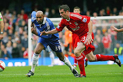 Chelsea striker Nicolas Anelka (left) and Liverpool defender Jamie Carragher fight for the ball. The Reds held on to win the game 1-0, and break Chelsea's long unbeaten record at Stamford Bridge