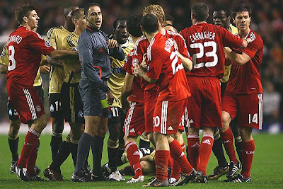 Referee Olegario Benquerenca separates the players as Mamadou Niang of Marseille squares up to Javier Mascherano of Liverpool. For all the fight Marseille could muster though, it was not enough as Liverpool won 1-0 to advance to the last 16 in the Champions League