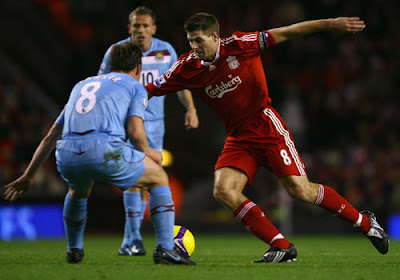 Steven Gerrard of Liverpool looks for a way past Scott Parker of West Ham United