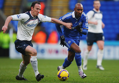Nicolas Anelka of Chelsea holds off Andy O'Brien of Bolton Wanderers
