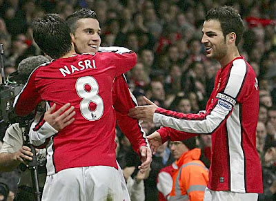 Arsenal's Robin van Persie (second left) is congratulated by teammates after scoring against Liverpool.