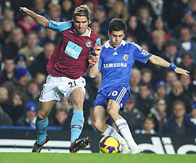 Joe Cole of Chelsea is challenged by Valon Behrami of West Ham United during their Premier League match at Stamford Bridge on December 14, 2008 in London, England