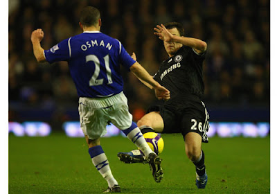 John Terry of Chelsea tackles Leon Osman of Everton