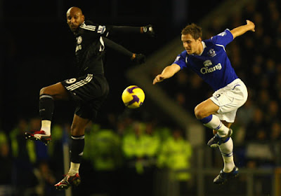 Phil Jagielka of Everton competes for the ball with Nicolas Anelka of Chelsea