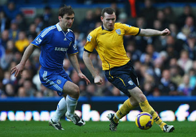 Craig Beattie of West Bromwich Albion is watched by Branislav Ivanovic of Chelsea