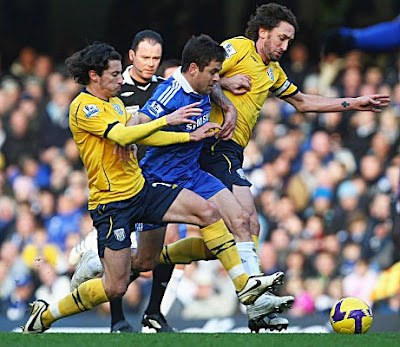 Joe Cole of Chelsea goes between Robert Koren (left) and Jonathan Greening of West Bromwich Albion (right) during their Barclays Premier League match at Stamford Bridge in London, England