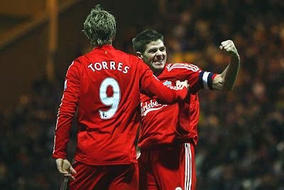 Fernando Torres celebrates with teammate Steven Gerrard of Liverpool after scoring his team's second goal. Both players were making 'comebacks' as Torres returned from injury and Gerrard played in his first game since his recent troubles with the law. Liverpool won the match 2-0 to advance to the fourth round of the FA Cup.