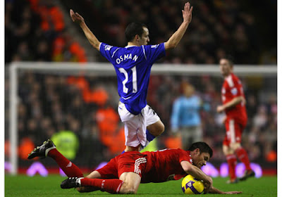 Xabi Alonso of Liverpool tangles with Leon Osman of Everton