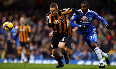 Andy Dawson of Hull City battles for the ball with Salomon Kalou of Chelsea