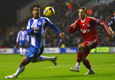 Mido of Wigan Athletic battles with Lucas Leiva of Liverpool