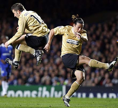 Juventus' Alessandro Del Piero (L) jumps out of the way as teammate Mauro Camoranesi (R) takes a shot at goal against Chelsea.