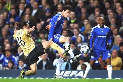 Mauro Camoranesi of Juventus challenges Michael Ballack of Chelsea during their UEFA Champions League Round of 16 first-leg match at Stamford Bridge in London, England.